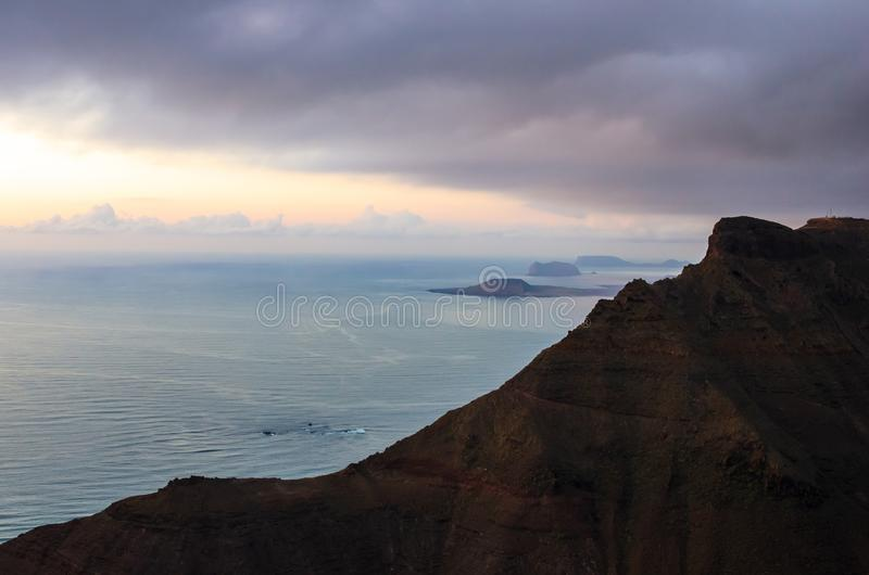 Landscape of cliffs of Mirador del Río and archipelago of Chinijo in background stock photo