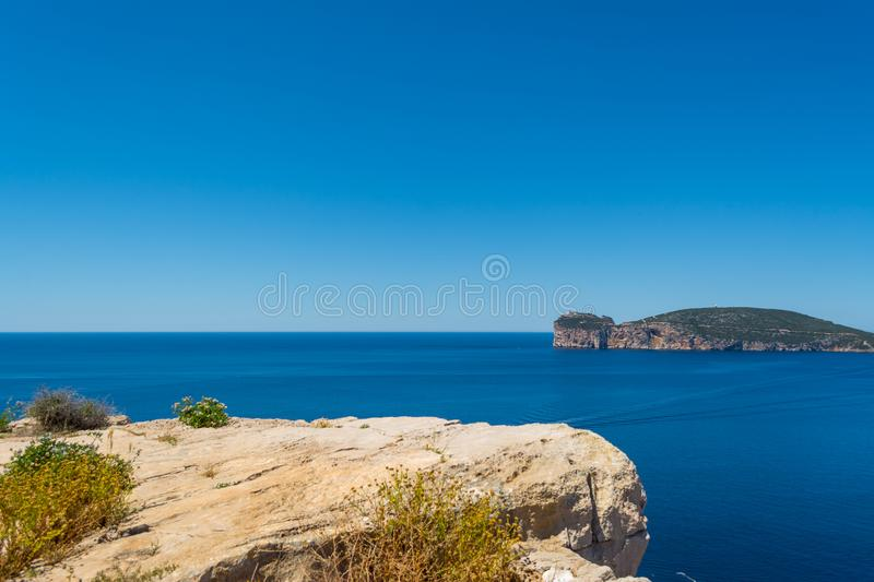 Landscape of the coast of Capo Caccia, in Sardinia. Sea, rock, travel, water, blue, coastline, alghero, tourism, shore, nature, sky, island, beautiful royalty free stock image