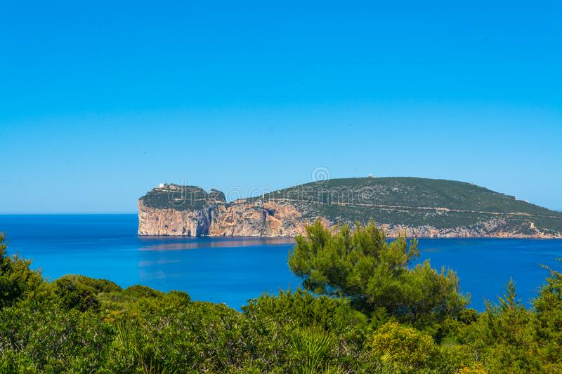 Landscape of the coast of Capo Caccia, in Sardinia. Viewed from Punta Giglio, sea, rock, travel, water, blue, coastline, alghero, tourism, shore, nature, sky stock photos