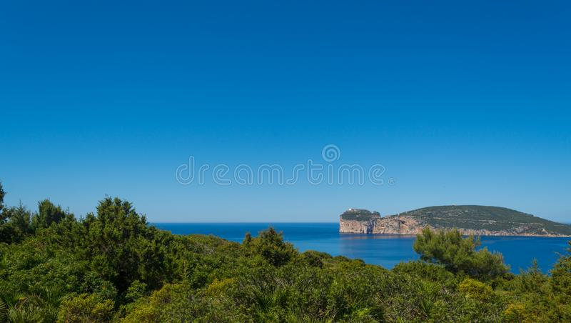 Landscape of the coast of Capo Caccia, in Sardinia. Viewed from Punta Giglio, sea, rock, travel, water, blue, coastline, alghero, tourism, shore, nature, sky royalty free stock image