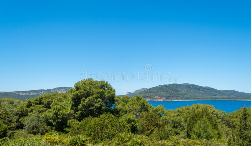 Landscape of the coast of Capo Caccia, in Sardinia. Viewed from Punta Giglio, sea, rock, travel, water, blue, coastline, alghero, tourism, shore, nature, sky royalty free stock photography