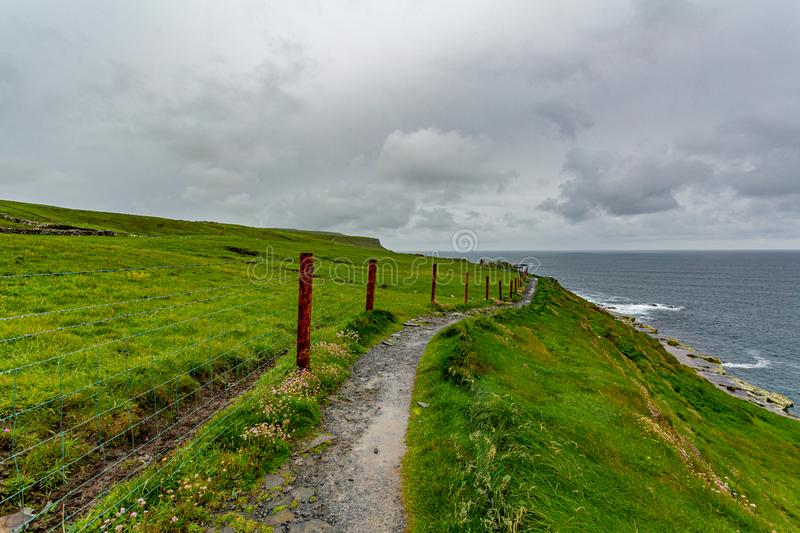 Landscape of the coast and a rural footpath in of the coastal route walk stock image