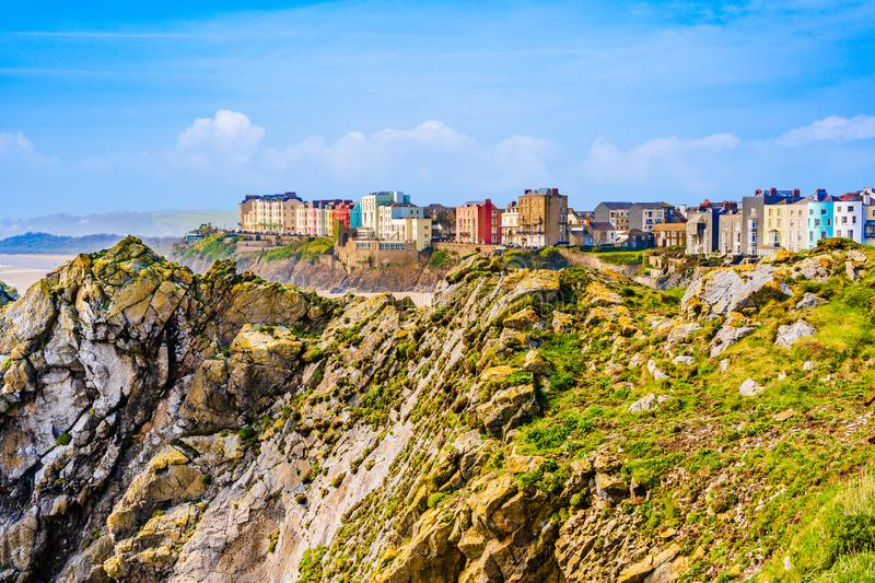 Landscape of colorful houses behind cliffs in Tenby a harbour town and resort in Pembrokeshire, southwest Wales, UK stock photography