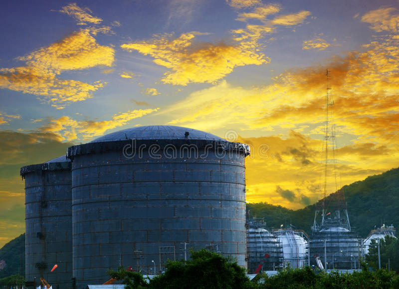 Landscape of construction site oil storage tank in refinery petrochemical industry plant against beautiful dusky sky royalty free stock image