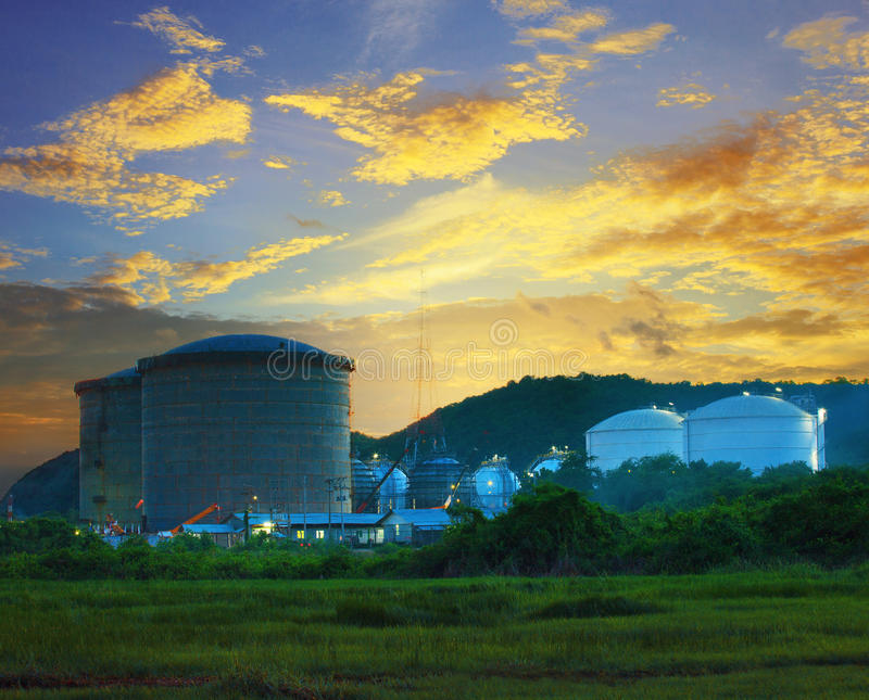 Landscape of construction site oil storage tank in refinery. Petrochemical industry plant against beautiful dusky sky stock photography