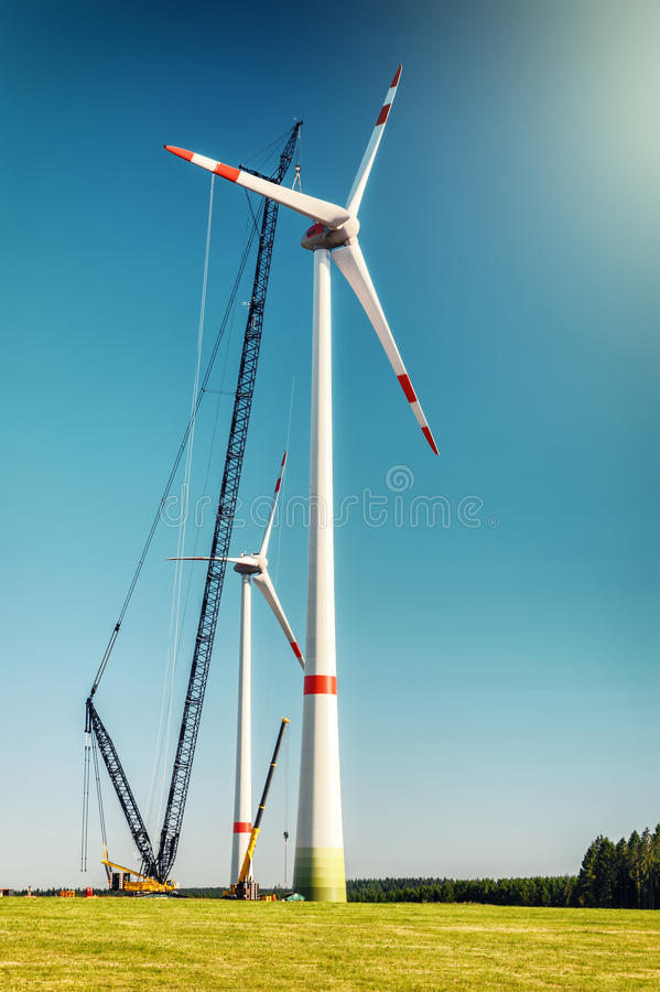 Landscape with construction site of wind turbines. Industrial concept stock image
