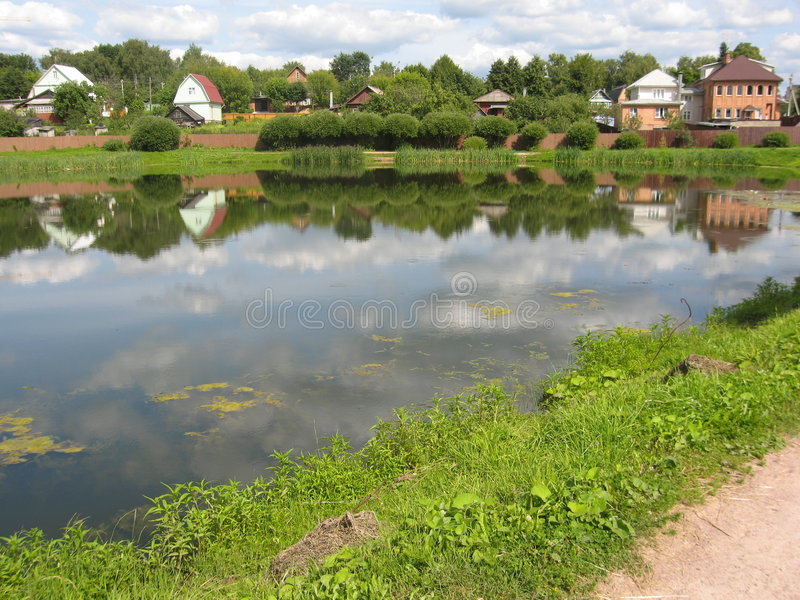 Landscape with cottages and lake 2 royalty free stock images