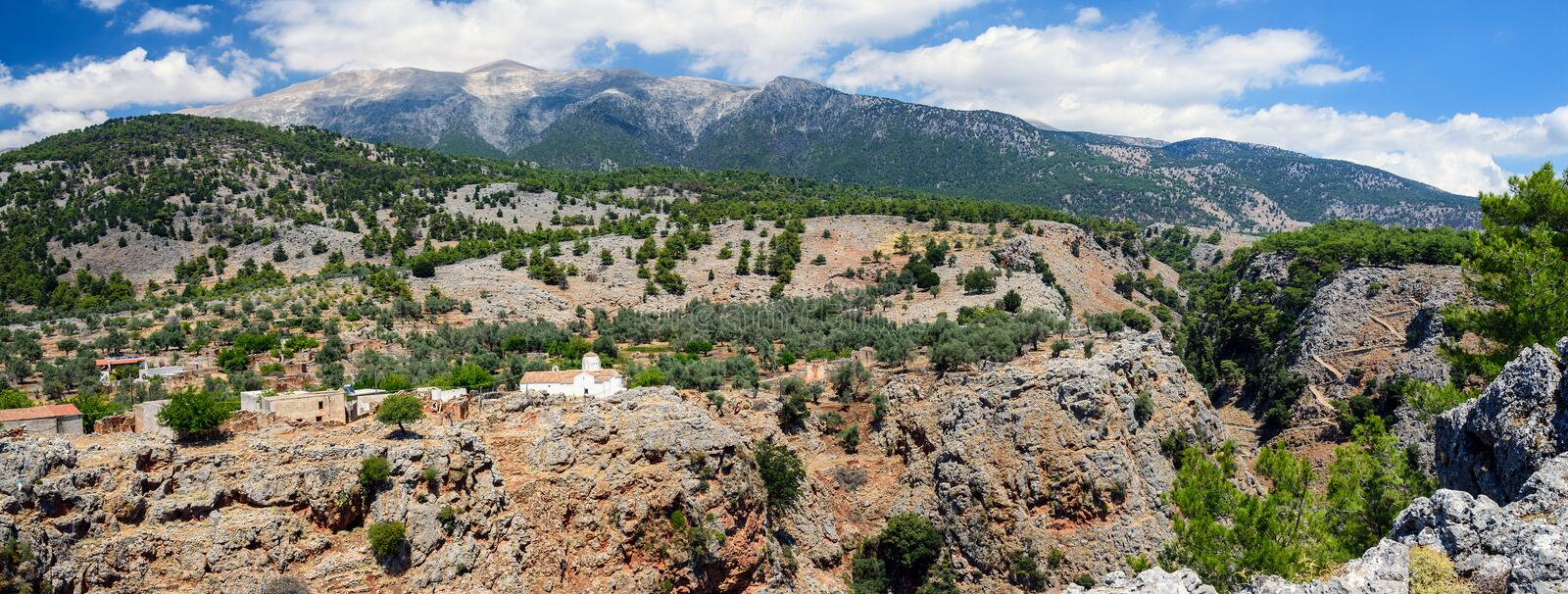 Landscape of Crete island with small white church on the rock of Aradena gorge, Crete island, Greece stock photography