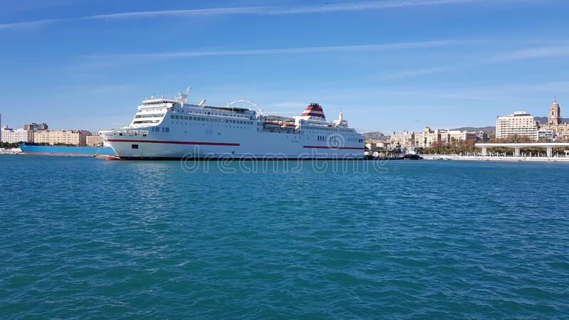 A landscape with a cruise ship, on a sunny day in harbor. royalty free stock photography
