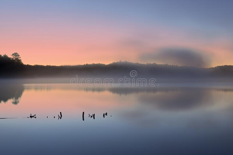 Pete`s Lake at Dawn. Landscape at dawn of the shoreline of Pete`s Lake, Hiawatha National Forest, Michigan`s Upper Peninsula, USA stock photography