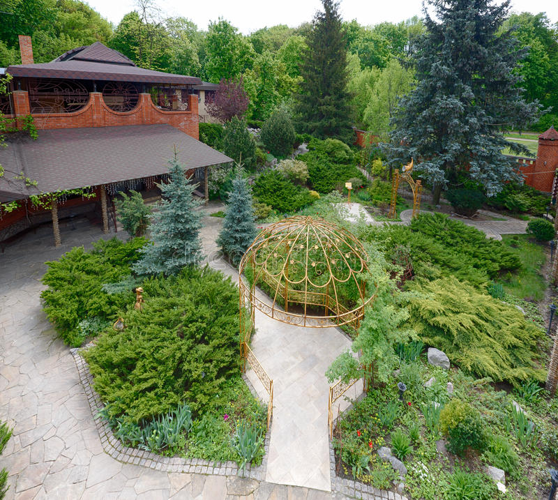 Download Landscape Design Evergreen Bushes And Path Stock Image