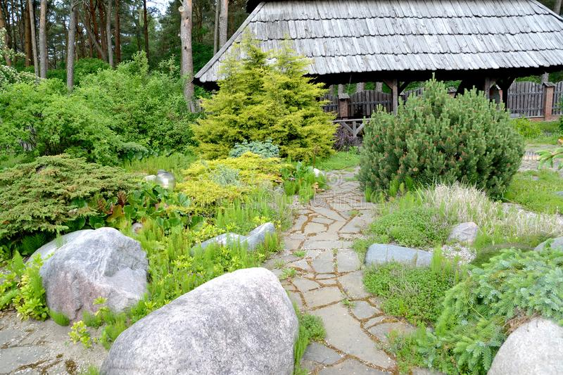 Landscape design with a footpath on the seasonal dacha.  stock photo