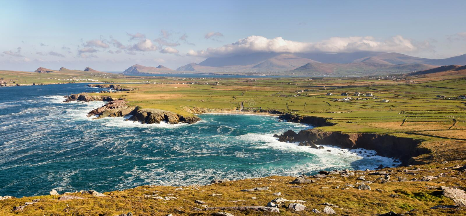 Landscape on Dingle peninsula. Co Kerry, Ireland with Clogher strand beach, the three sister hills and part of Sybil head. Brandon mountain is in the background royalty free stock photos