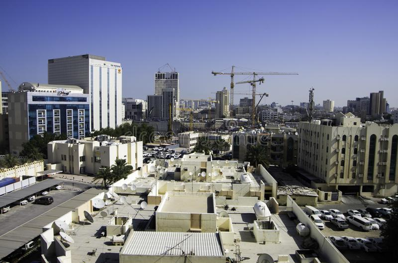 Landscape of Doha under construction with building sites and cra. Doha, QATAR -DECEMBER 25, 2016: Landscape of Doha under construction with building sites and royalty free stock image