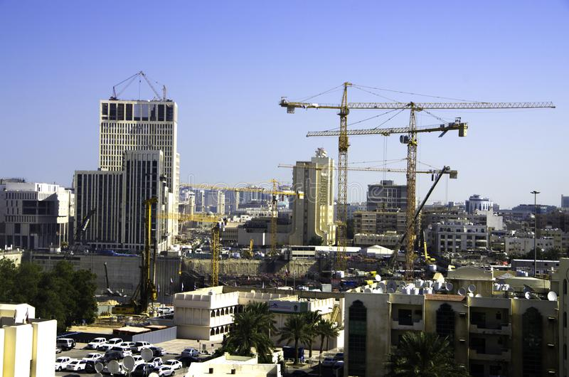Landscape of Doha under construction with building sites and cra. Doha, QATAR -DECEMBER 25, 2016: Landscape of Doha under construction with building sites and stock image