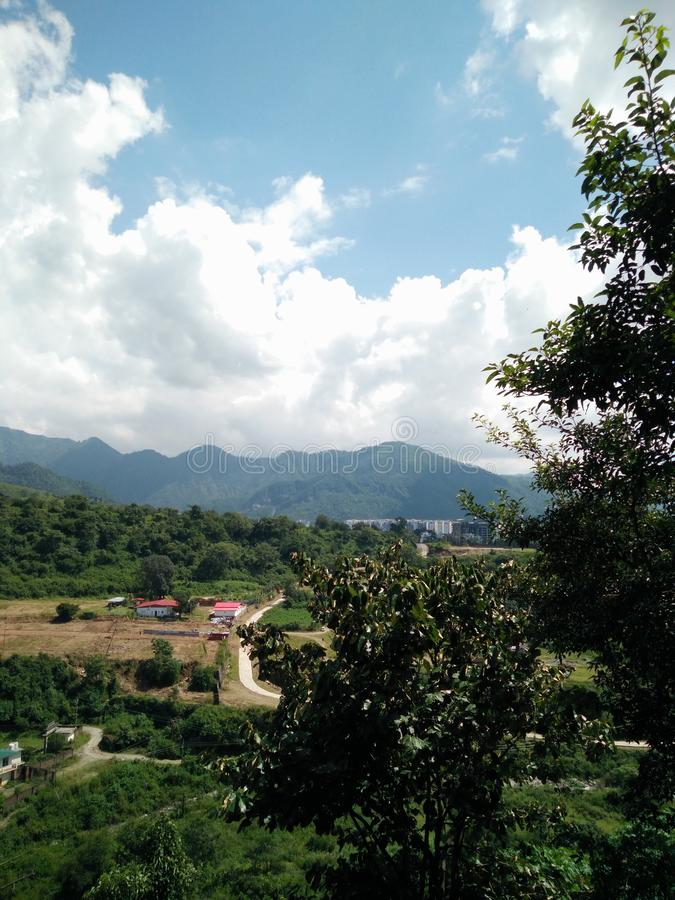 Landscape Doon valley India clouds hills forest fields stock photos