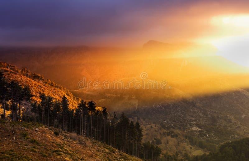 Landscape with dramatic light. Mountainous landscape with dramatic morning light stock image