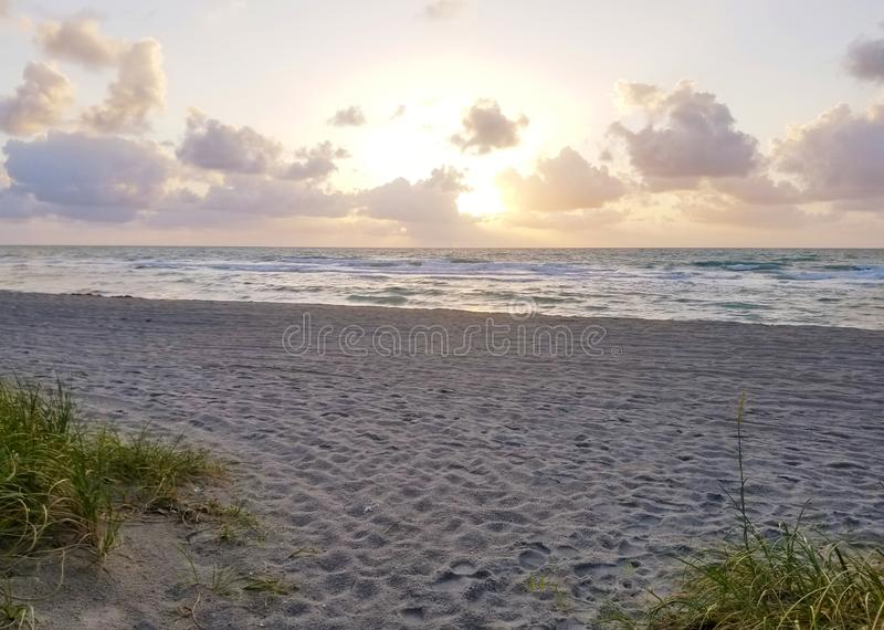 Landscape of dunes, beach and ocean at sunrise royalty free stock photography