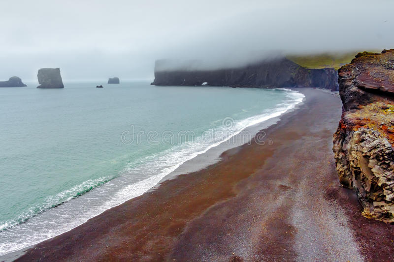 Landscape of Dyrholaey cape, volcanic sand beach, South Iceland. royalty free stock images