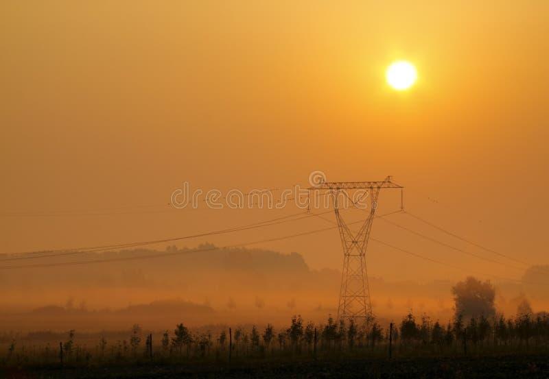 Landscape with electricity transmission pylon stock images