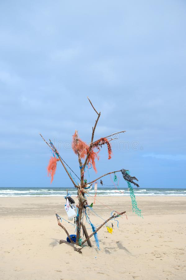 Landscape empty beach with rubbish tree royalty free stock photo
