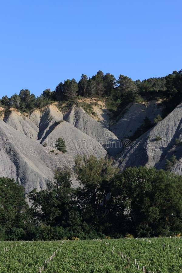 Landscape eroded with black marls in Corbieres, France. Landscape eroded with black marls in Corbieres, Aude in Occitanie. South of France stock image