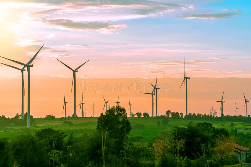 Landscape of farm big wind turbines which alternative energy innovation for production electricity energy from wind .Energy stock photography