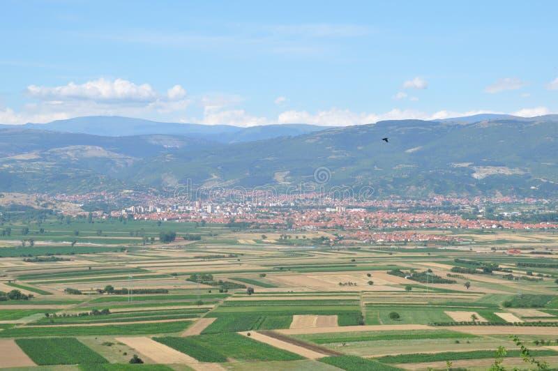 Landscape of fields around the city stock photo