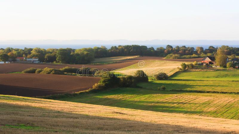 Rural landscape with fields and hills stock photos