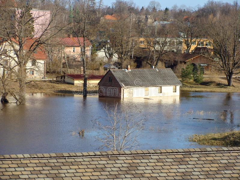 Landscape with flooded river, view from above over the roof. Spring landscape with flooded river, view from above over the roof stock images