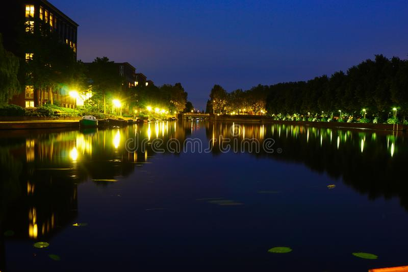 Landscape foto of amsterdam near at night. Landscape foto of amsterdam near erasmus park at night royalty free stock photo