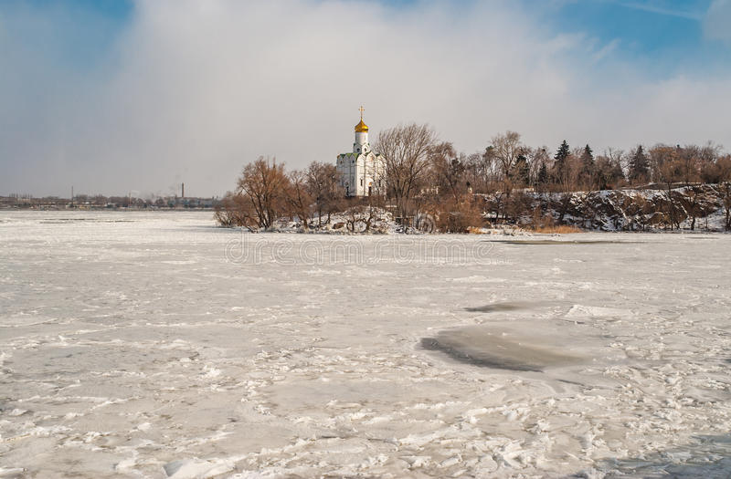 Landscape with frozen river Dnepr and Orthodox church. On Monastyrsky island in Denpropetrovsk city, Ukraine royalty free stock images