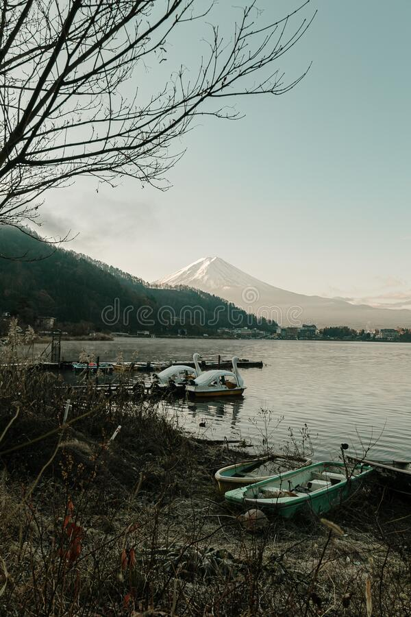 Landscape of Fuji mountain view and Kawaguchiko lake with boats in morning sunrise, winter seasons at yamanachi, Japan. Landscape of Fuji mountain view and stock photography