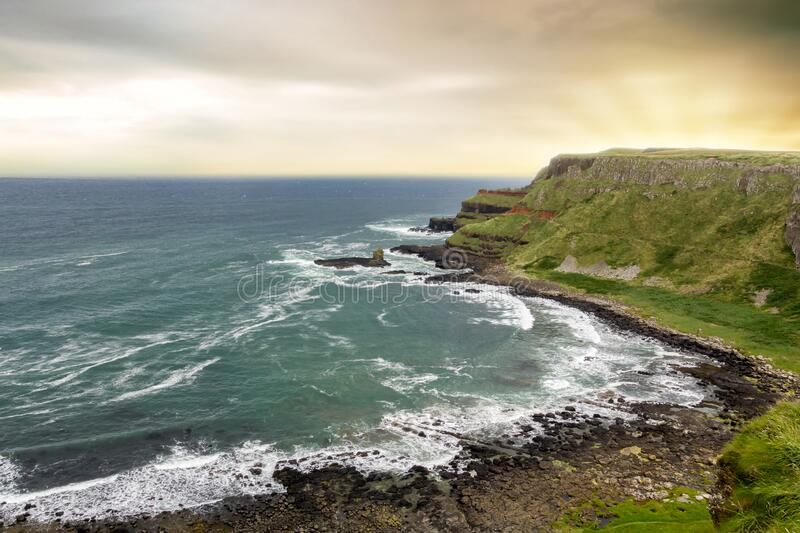 Landscape of Giant`s Causeway trail in Northern Ireland in United Kingdom. UNESCO heritage.  stock photos