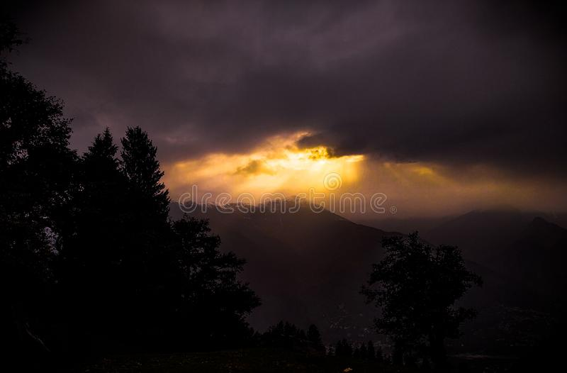 landscape of morning sun-rays on the himalayan mountain with shiny snow royalty free stock images