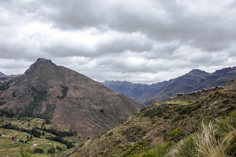 Landscape with green Andean Mountains and Inca ruins on the hiking path in Pisac archeological park, Peru stock photo