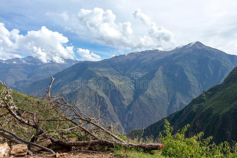 Landscape with green deep valley, Apurimac River canyon, Peruvian Andes mountains on Choquequirao trek in Peru. Apurimac River in green deep valley with white stock photography