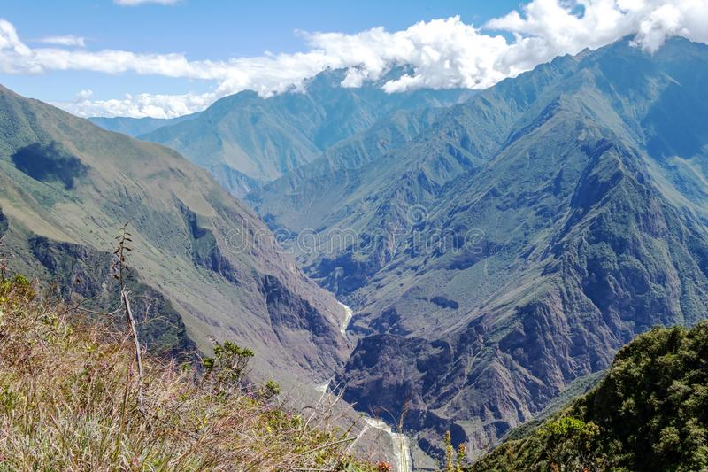 Landscape with green deep valley, Apurimac River canyon, Peruvian Andes mountains on Choquequirao trek in Peru. Apurimac River in green deep valley with white stock photos