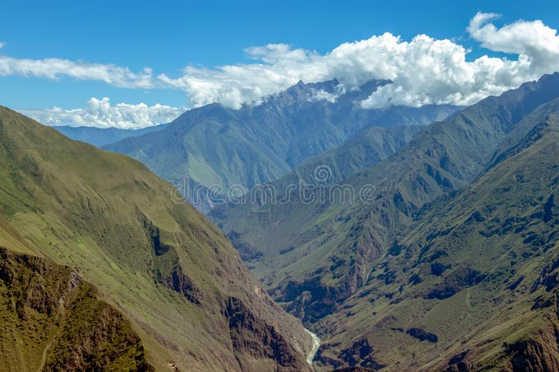 Landscape with green deep valley, Apurimac River canyon, Peruvian Andes mountains on Choquequirao trek in Peru. Apurimac River in green deep valley with white stock images