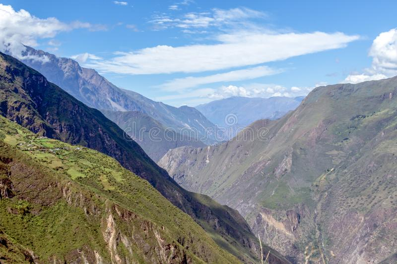 Landscape with green deep valley, Apurimac River canyon, Peruvian Andes mountains on Choquequirao trek in Peru. Apurimac River in green deep valley with white royalty free stock photo