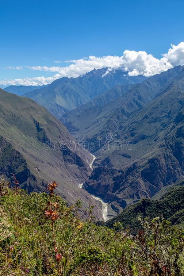 Landscape with green deep valley, Apurimac River canyon, Peruvian Andes mountains on Choquequirao trek in Peru. Apurimac River in green deep valley with white stock photo