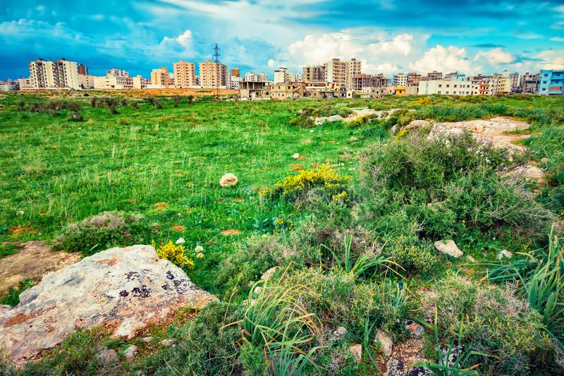 Landscape with green valley and Tripoli city stock photos