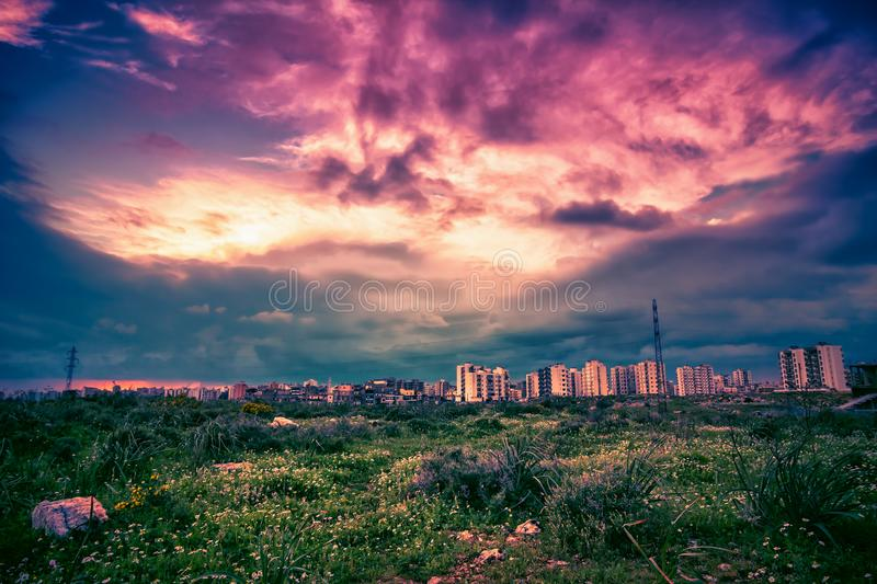 Landscape with green valley and Tripoli city at sunset royalty free stock images