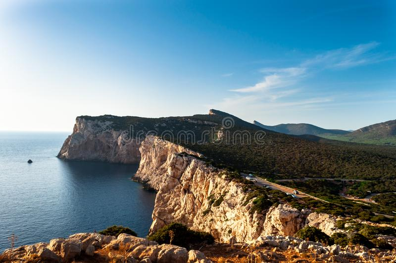 Landscape of the gulf of capo caccia. From the Cave of broken vessels at sunset stock photography