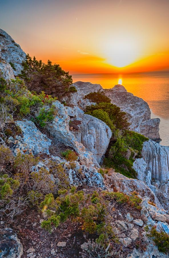 Landscape of the gulf of capo caccia. From the Cave of broken vessels at sunset, alghero, adventure, beach, blue, capocaccia, coast, coastline, grotta, dei royalty free stock image