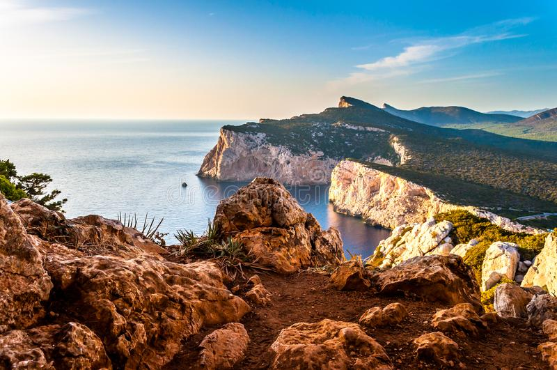 Landscape of the gulf of capo caccia. From the Cave of broken vessels at sunset, alghero, adventure, beach, blue, capocaccia, coast, coastline, grotta, dei royalty free stock photos