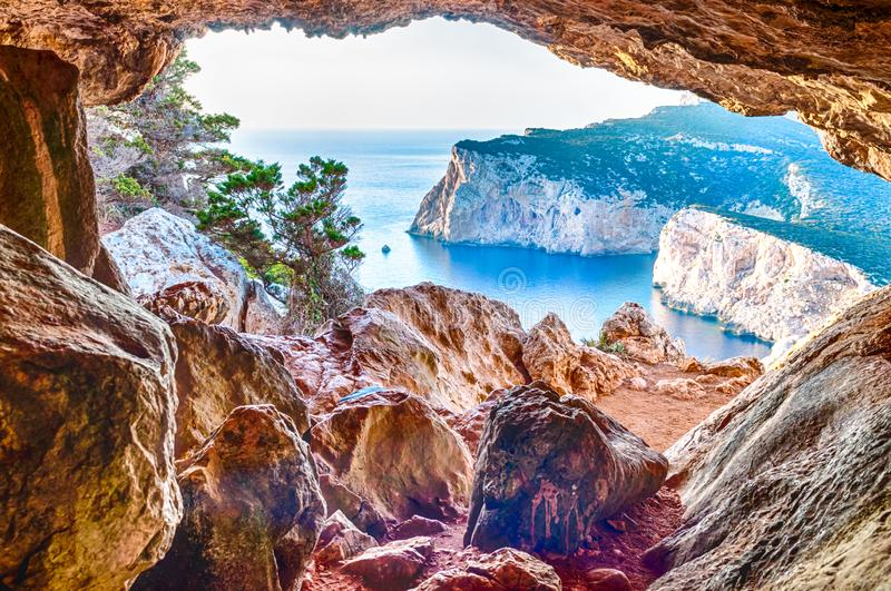 Landscape of the gulf of capo caccia. From the Cave of broken vessels at sunset, alghero, adventure, beach, blue, capocaccia, coast, coastline, grotta, dei stock photos