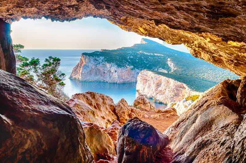 Landscape of the gulf of capo caccia. From the Cave of broken vessels at sunset, alghero, adventure, beach, blue, capocaccia, coast, coastline, grotta, dei stock photography