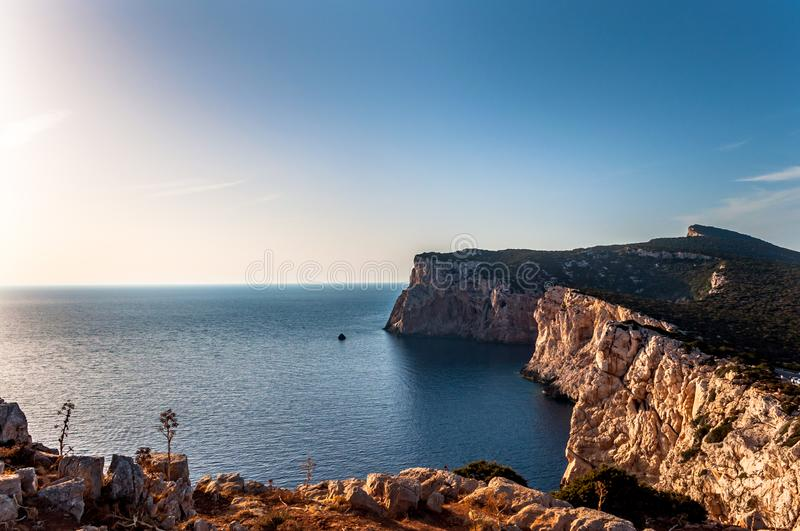 Landscape of the gulf of capo caccia. From the Cave of broken vessels at sunset, alghero, adventure, beach, blue, capocaccia, coast, coastline, grotta, dei royalty free stock photo