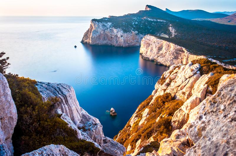 Landscape of the gulf of capo caccia. From the Cave of broken vessels at sunset, alghero, adventure, beach, blue, capocaccia, coast, coastline, grotta, dei royalty free stock images